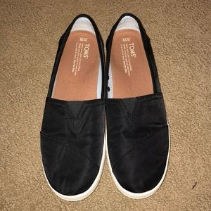 Black toms with rubberized soles